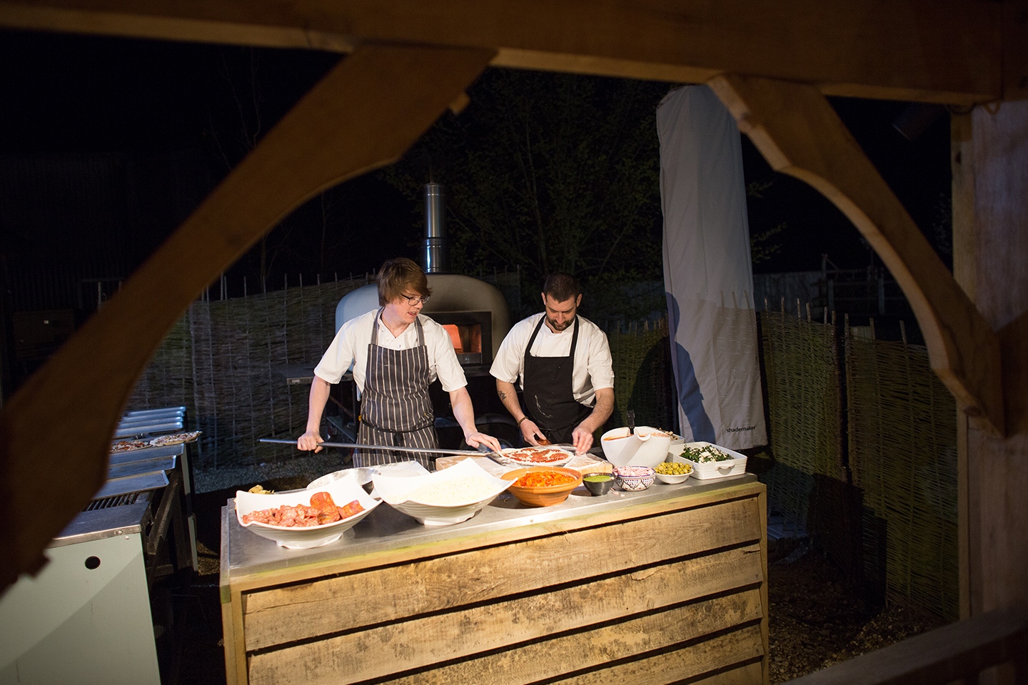 The couple served pizzas during their evening reception at Bassmead Manor Barns