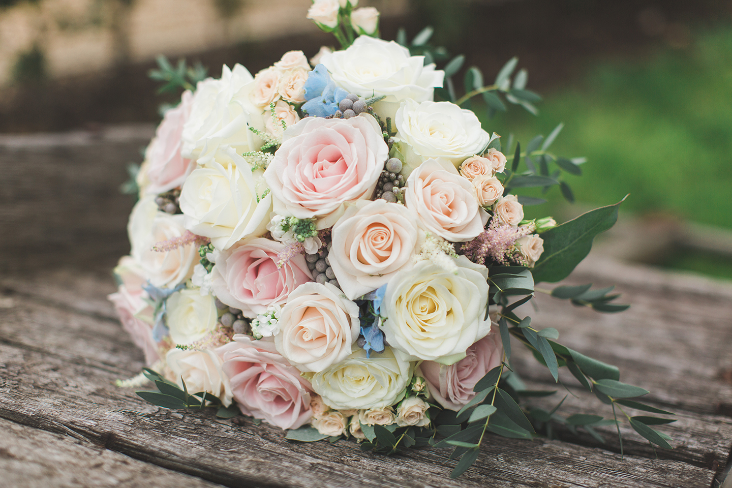 A spring wedding bouquet is made up of pastel florals for a wedding ceremony at Bassmead Manor Barns