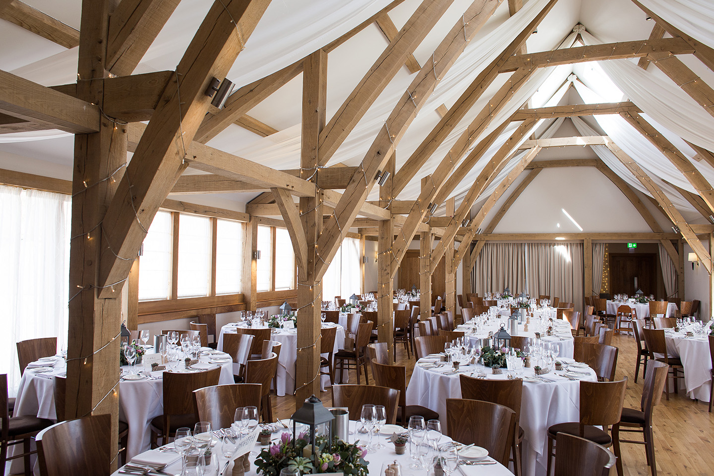 The Bridge Barn is set up for a country themed spring wedding at Bassmead Manor Brans