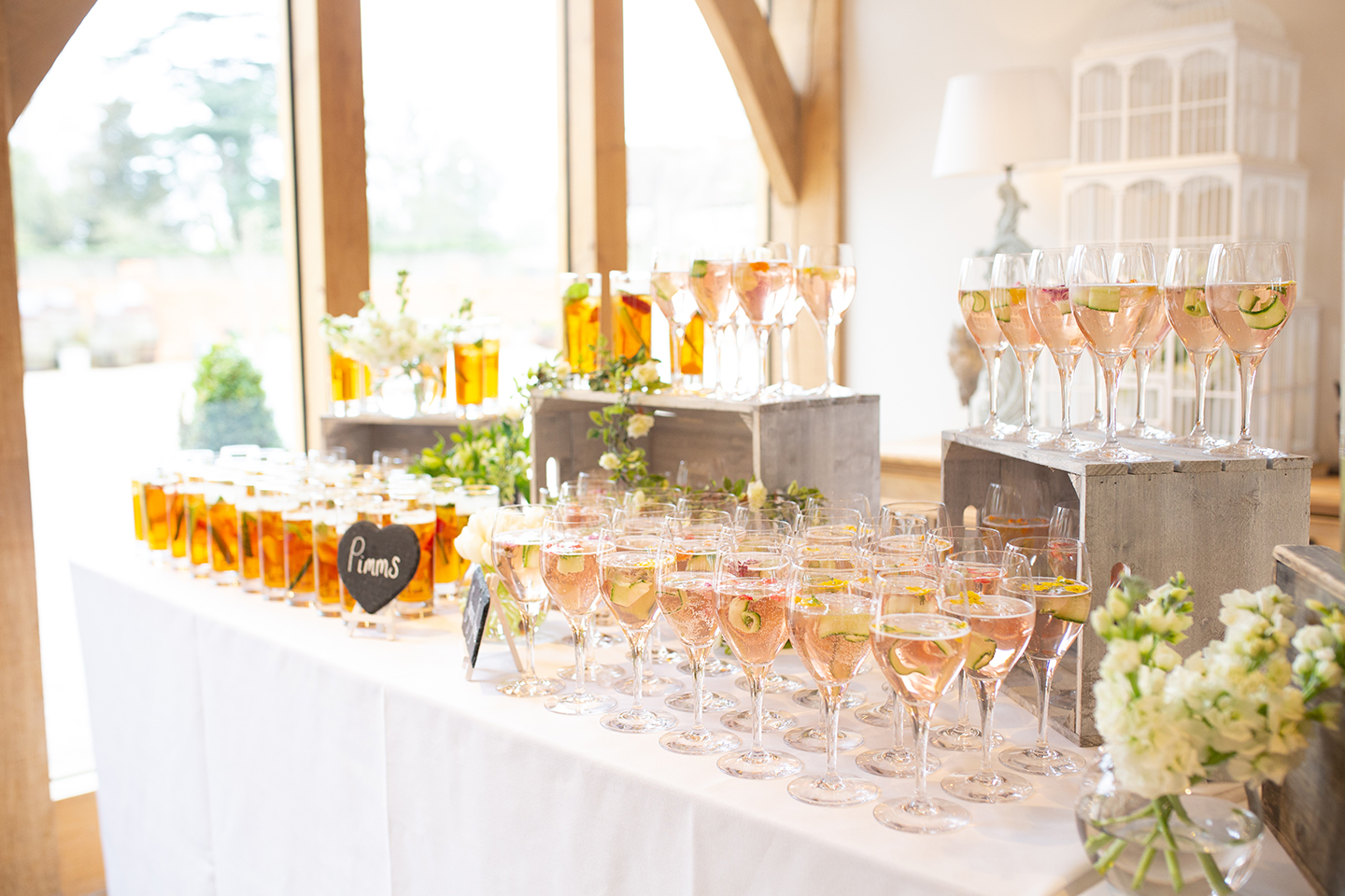 A cocktail station is set up for a spring wedding reception at Bassmead Manor Barns