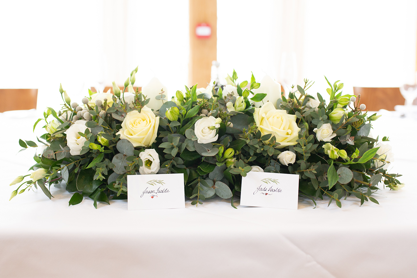 The couple chose white and green florals for their spring wedding at Bassmead Manor Barns