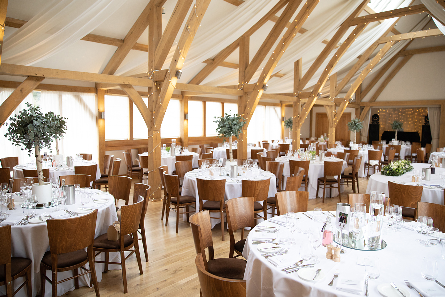 For this spring wedding at Bassmead Manor Barns the Bridge Barn was decorated with eucalyptus trees