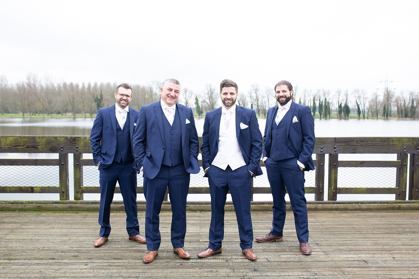 The groom and groomsmen wore navy wedding suits for this spring wedding at Bassmead Manor Barns