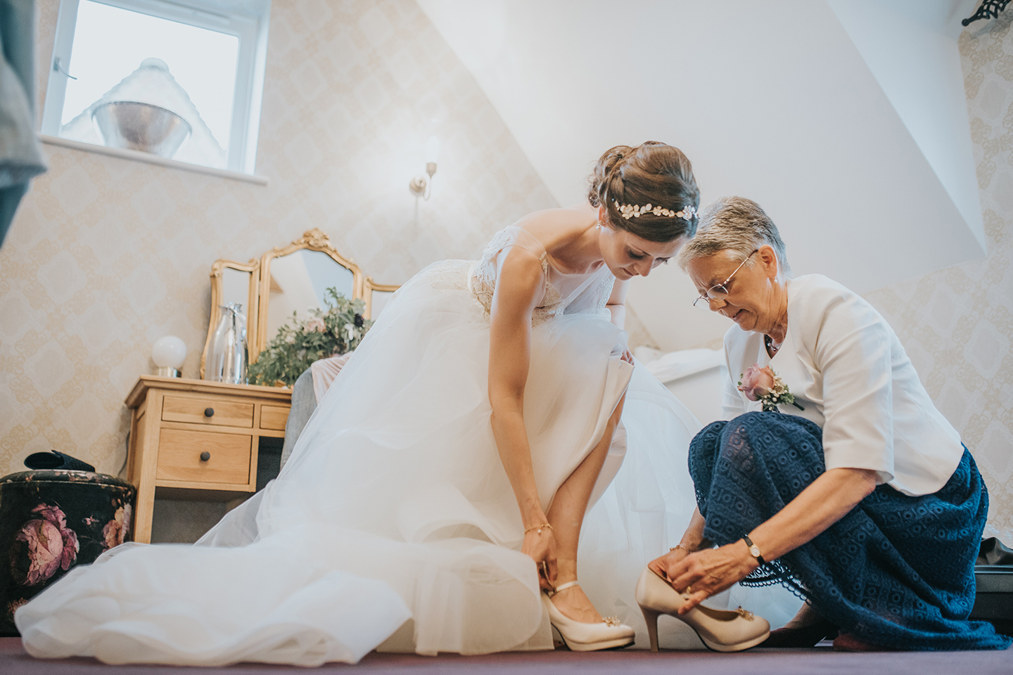 A bride makes her final wedding preparations in the Bridal Boudoir at Bassmead Manor Barns