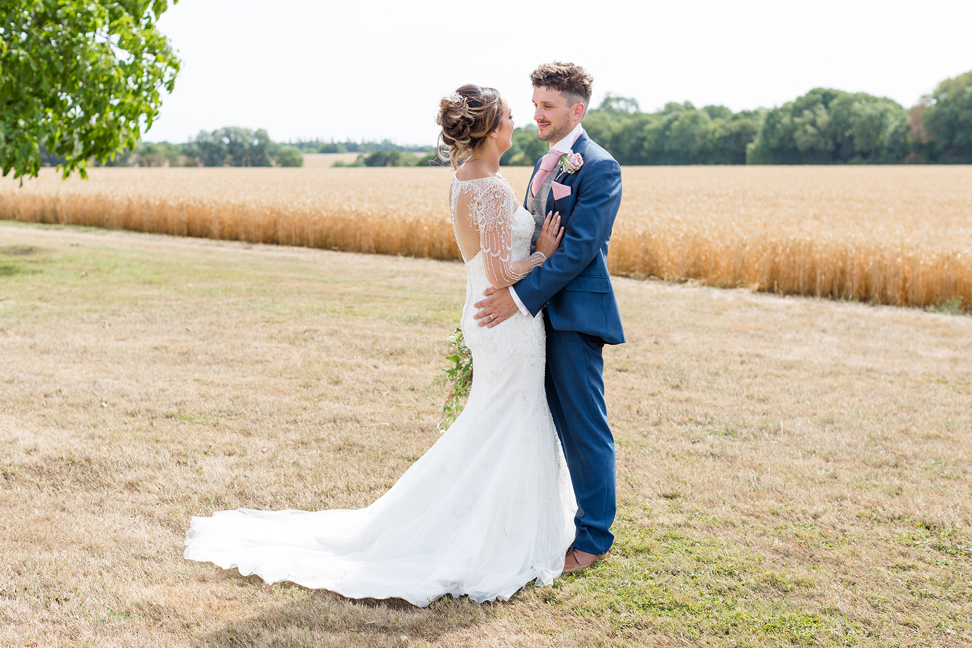 The bride and groom explore the Cambridgeshire countryside that surrounds Bassmead Manor Barns wedding venue
