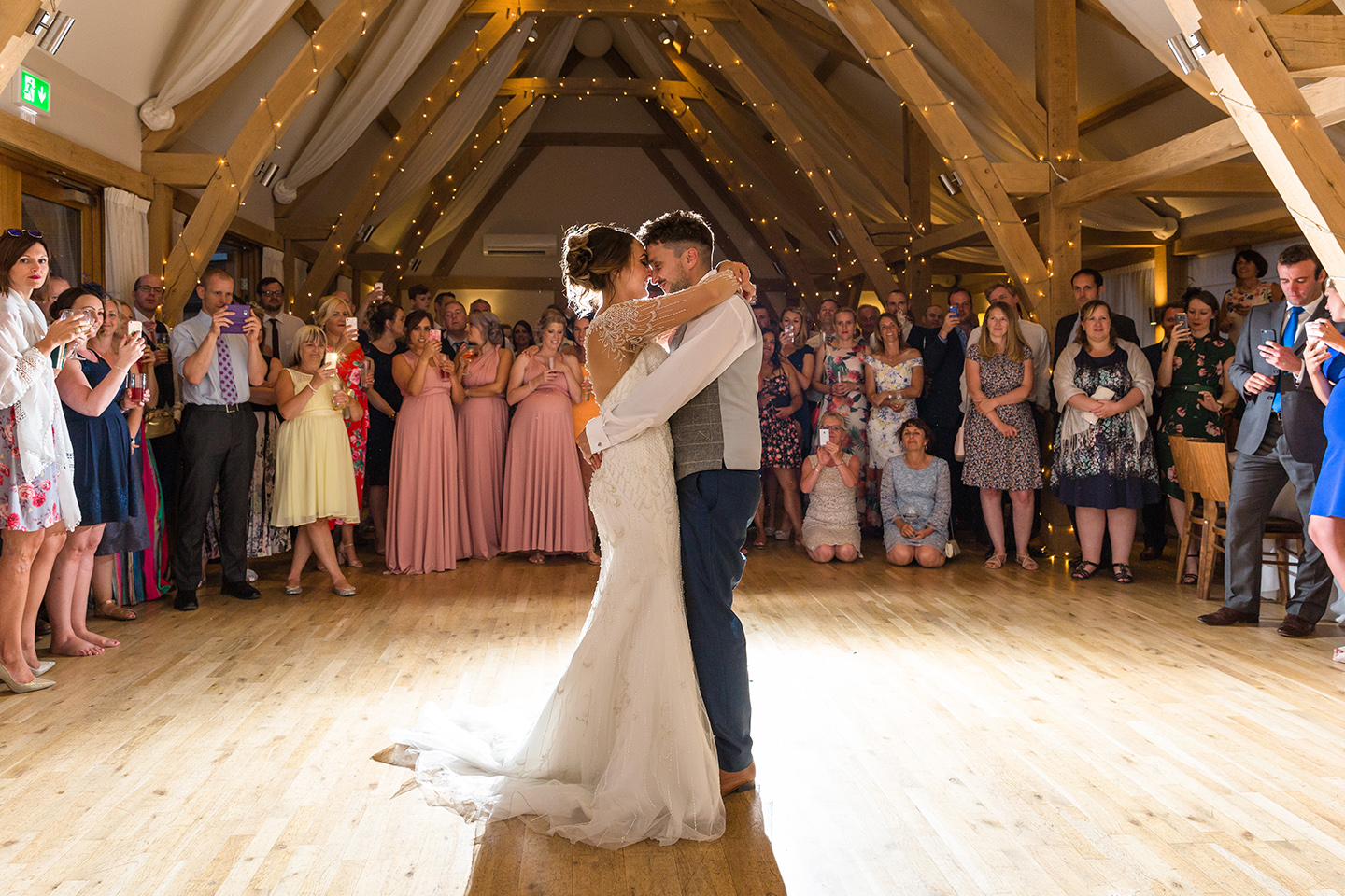 Newlyweds perform their first dance in the Bridge Barn at Bassmead Manor Barns