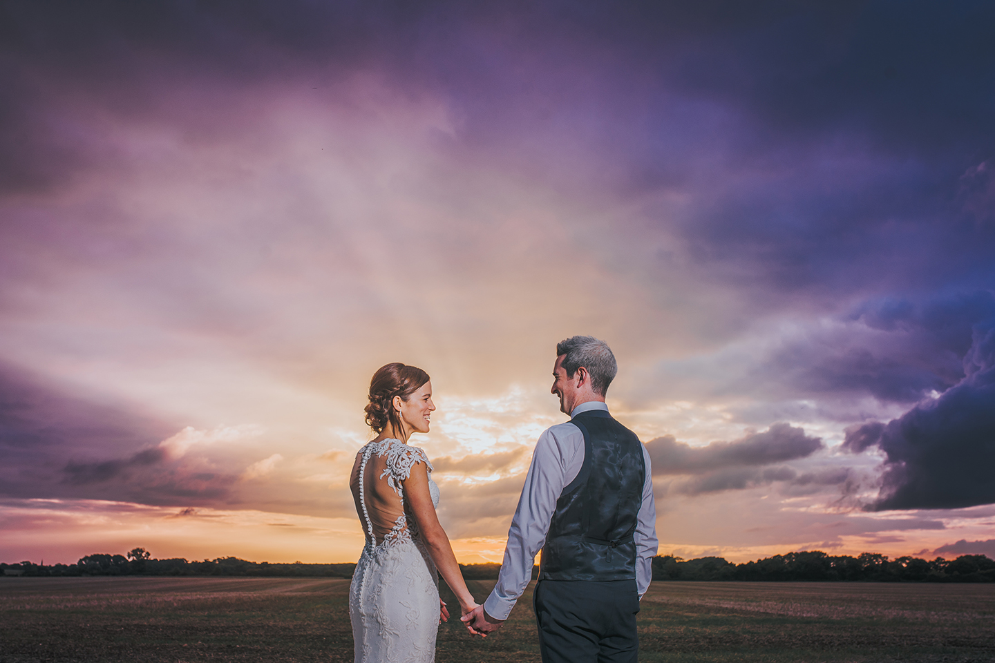Newlyweds make the most of the sunset at this countryside wedding venue in Cambridgeshire