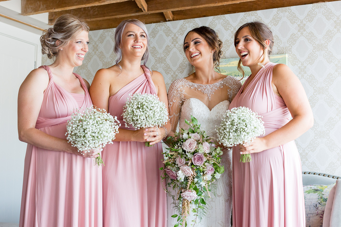 Bridesmaids wore pink multiway bridesmaid dresses for this summer wedding at Bassmead Manor Barns