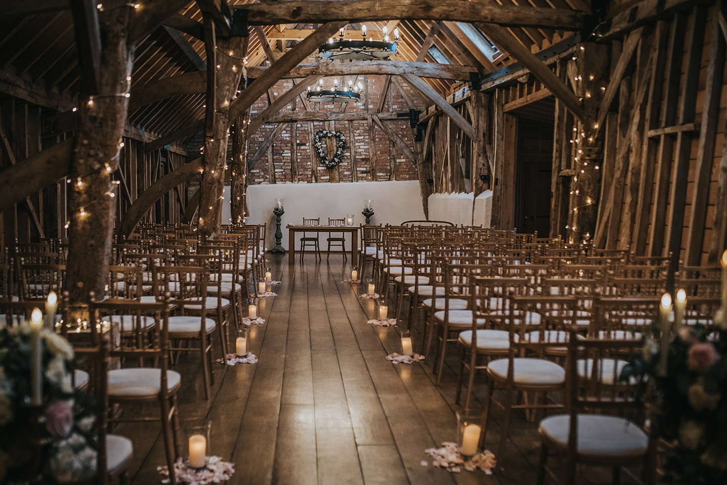 The Rickety Barn at Bassmead Manor Barns is set up for a beautiful wedding ceremony
