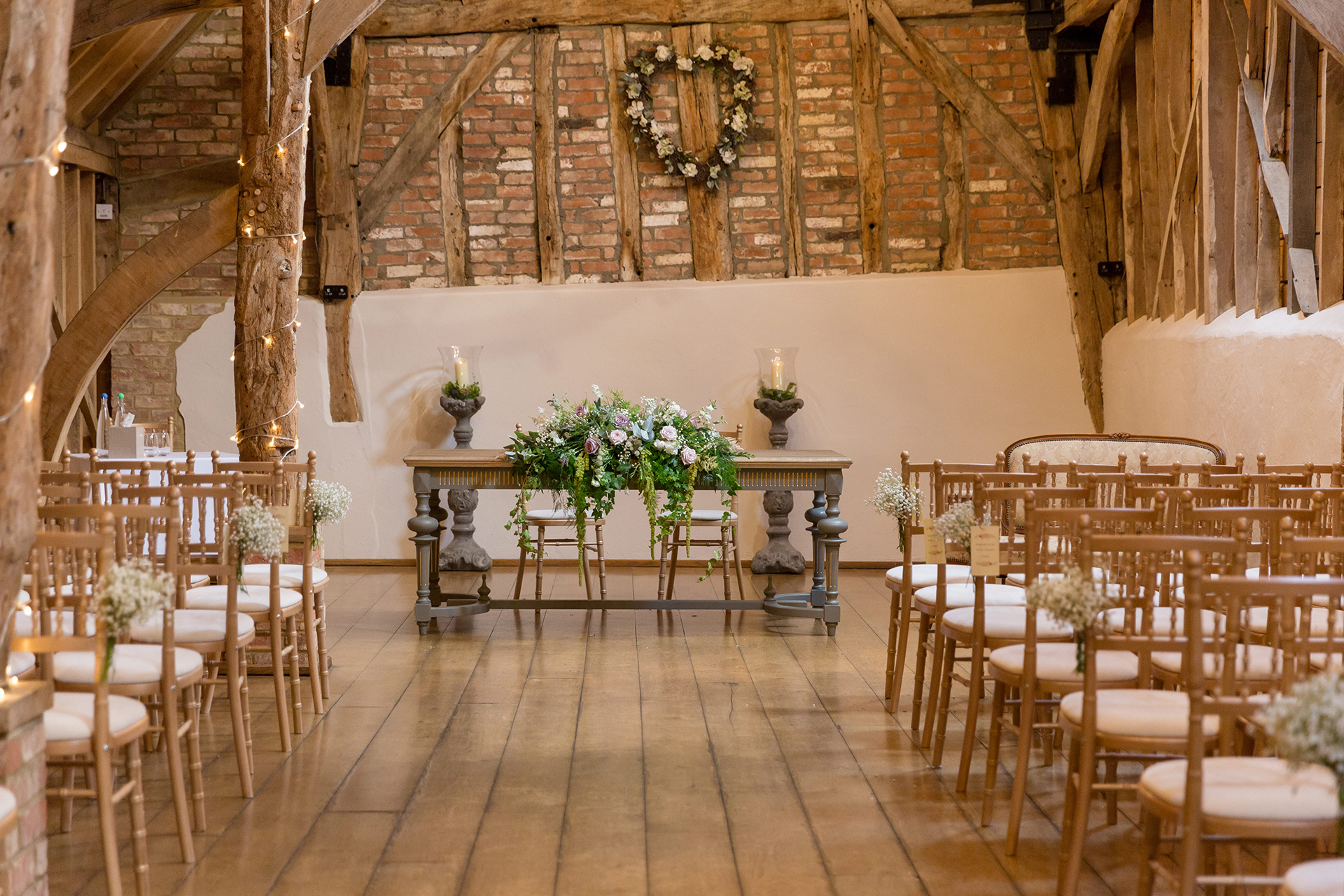 The Rickety Barn is set up for an elegant summer wedding ceremony