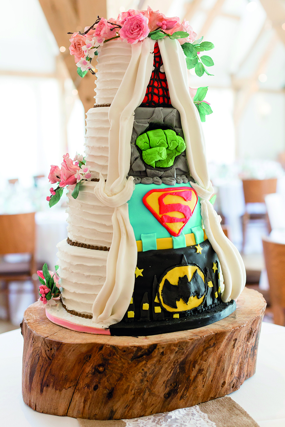For their summer wedding at Bassmead Manor Barns the couple embraced a superhero themed wedding cake