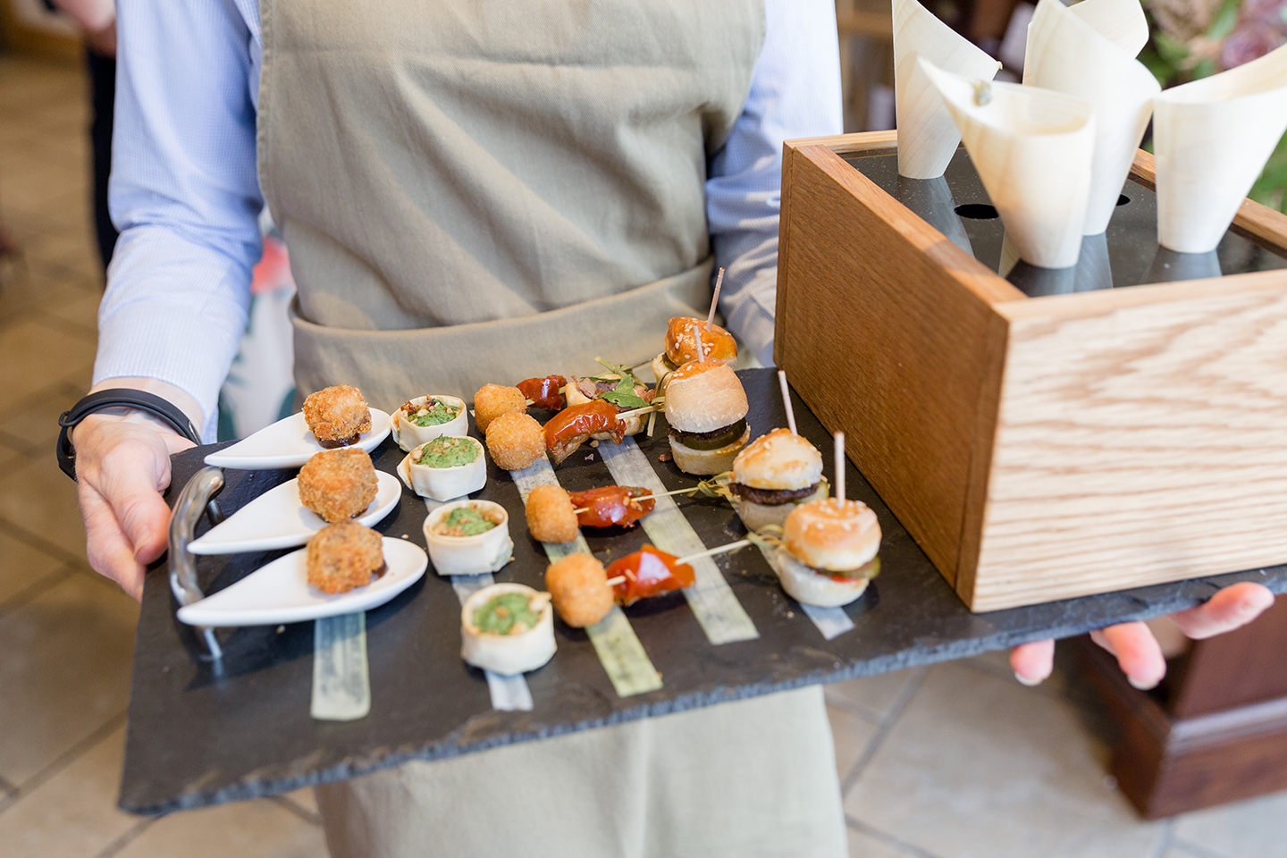 Wedding canapes are served during a summer wedding reception at Bassmead Manor Barns