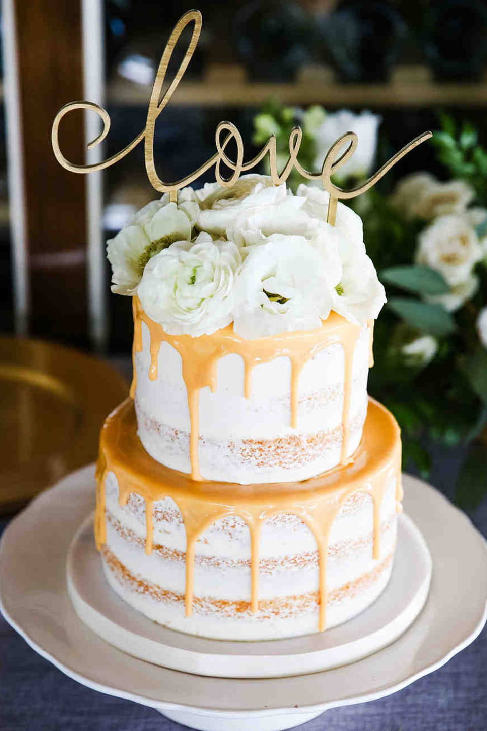 For a modern twist to your semi naked wedding cake at Bassmead Manor Barns add some decorative drip icing