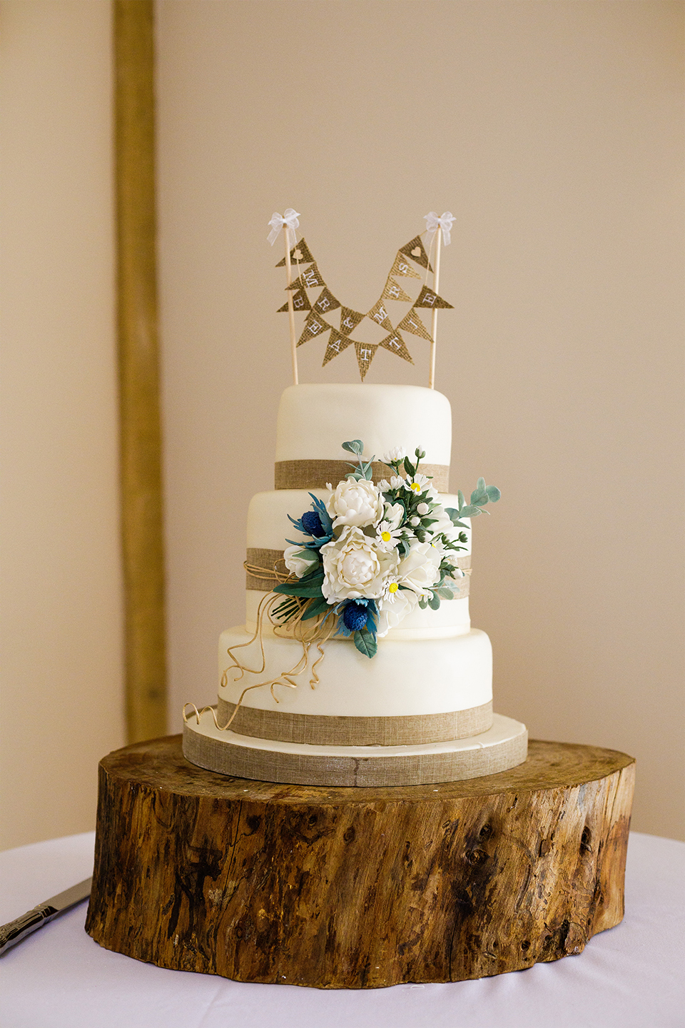 A bunting cake topper is perfect for a rustic wedding at Bassmead Manor Barns