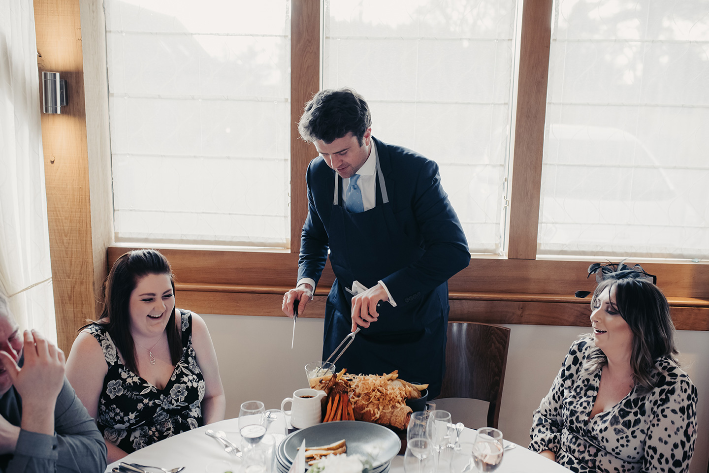 Guests gets involved by carving the meat ready for the main wedding meal