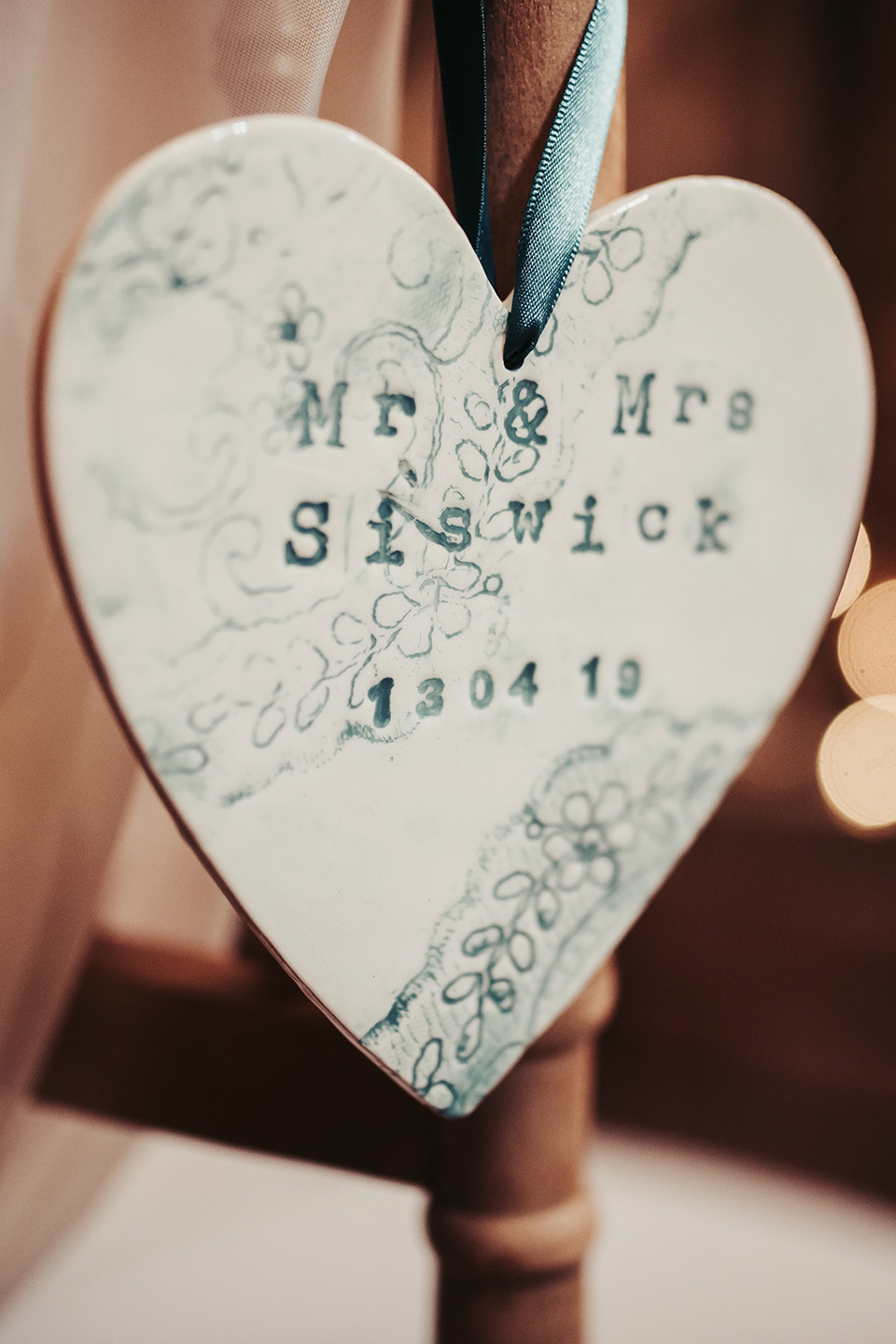 The couple decorated the venue with hints of teal and ceramic hearts