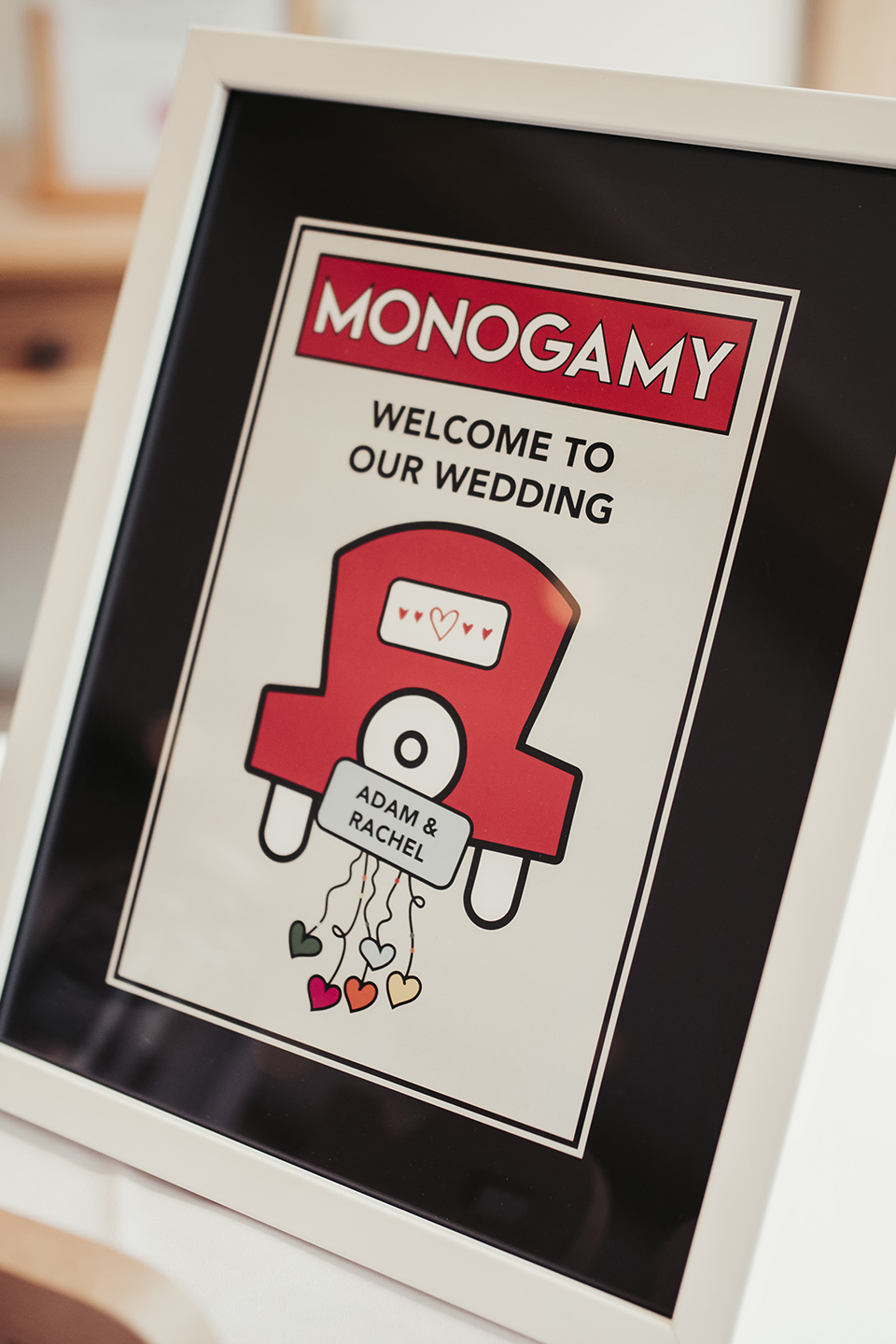 A wedding sign welcomes wedding guests with a monopoly theme